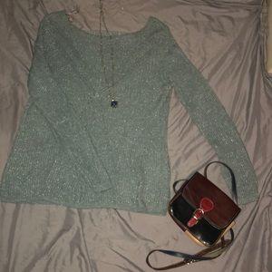 Maurice's teal sweater